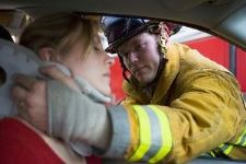 fireman helping lady in an Idaho Falls car crash