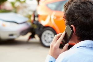 A man calling his lawyer after a car accident in Idaho Falls.