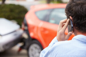 A man calling his attorney after a car accident in Idaho Falls.