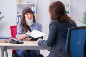 A client talking to her lawyer about personal injury in Idaho Falls.