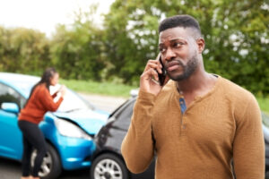 A man in Twin Falls calling his lawyer after a car accident.